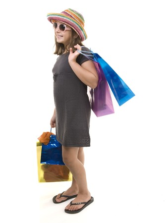 young girl child with shopping bags isolated on white photo