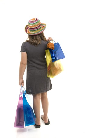young girl child with shopping bags  from behind, isolated on white. photo