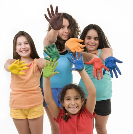 group of four young girls with their hands painted isolated on white. photo
