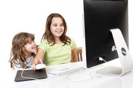 Two girls with desktop computer photo