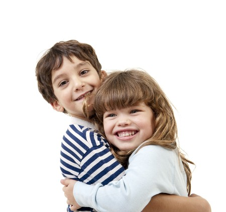 little boy and girl hugging isolated on white Stock Photo - 7955566