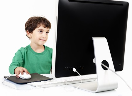 young boy with desktop computer isolated on white