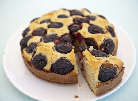 scrumptious: contry plum cake on a wooden surface