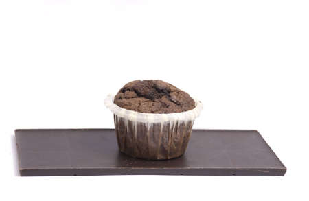 close-up on a chocolate and chocolate muffin, isolated on white photo