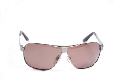 close up on pink trendy sunglasses, isolated on white photo