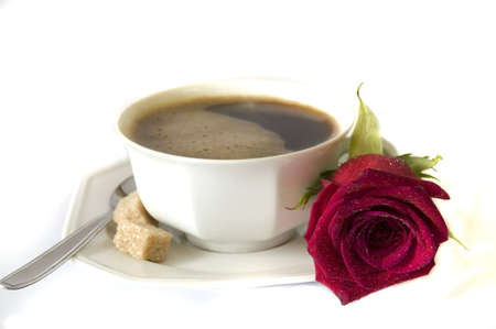 perfect morning surprise, whith love; fresh cup of coffee and fresh red rose, isolated on white
