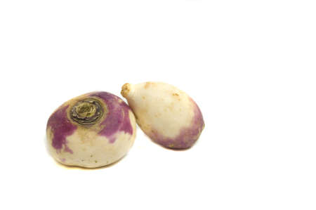 two fresh from the garden turnips, isolated on white