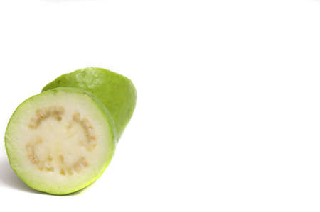 close up on a cut raw guava, isolated on white