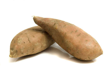 close-up on a couple of sweet potatoes, isolated on white, copy space Stock Photo