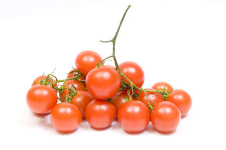fresh from the garden, ripe cherry tomatoes, isolated on white photo