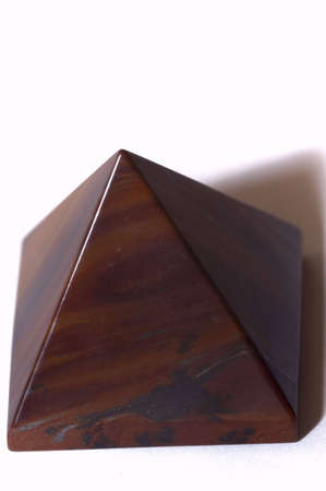 tiger-eye pyramid, isolated on white, copy space photo