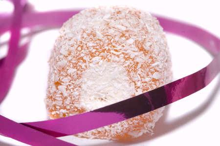 peach turkish delight, isolated on white photo
