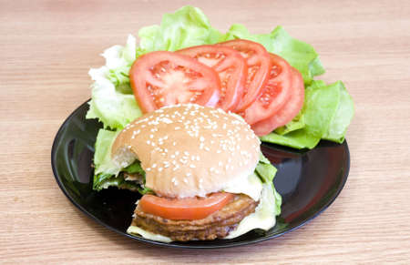 cant help to eat this yummy delicious cheeseburger photo