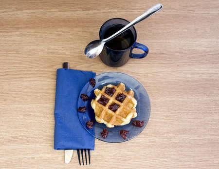 black tea and yummy jam waffle for breakfast photo
