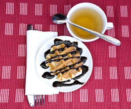 indulgent: chocolate waffle and herbal tea for a sweet indulgent breakfast