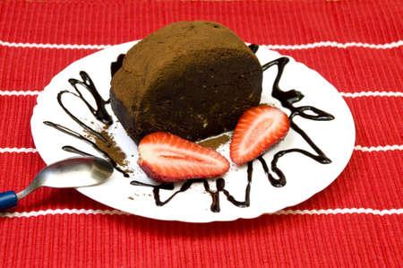 tasty sweet chocolate cake with fresh strawberries