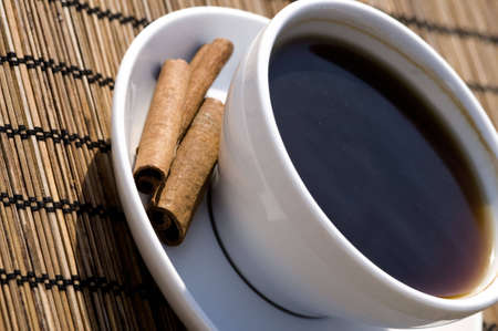outside, in the sun, indulge with a strong black coffee