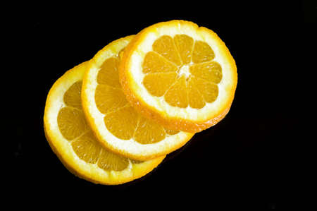 orange slices on black background