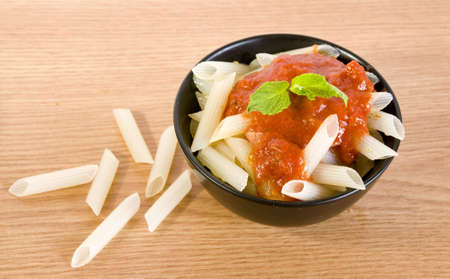 freshly cooked rice penne with hot tomato sauce