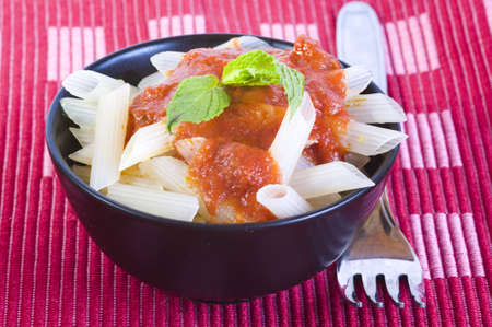 lunchtime-rice pasta with tomato sauce Banco de Imagens