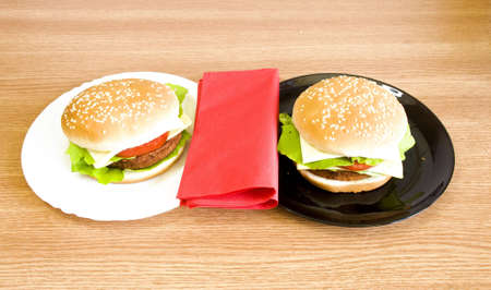 black and whote plates with hamburgers Stock Photo