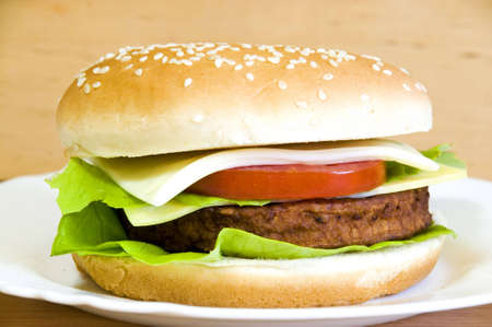 cheeseburger with beef, lettuce, cheese, onion and tomato Stock Photo
