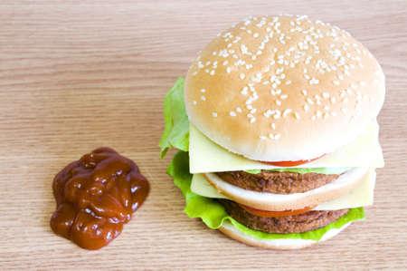 hamburger and ketchup, on light wood background Banco de Imagens