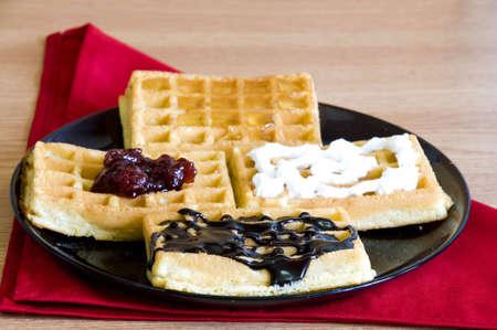 breakfast waffles, jam, chocolate, honey and whip cream Stock Photo