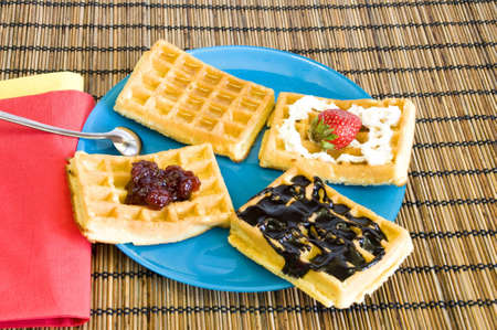 freshly made waffles with chocolate, jam, honey and strawberries Stock Photo - 6904436