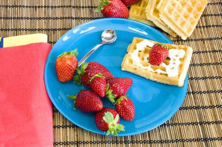 homemade light dessert, waffles with strawberries with light cream