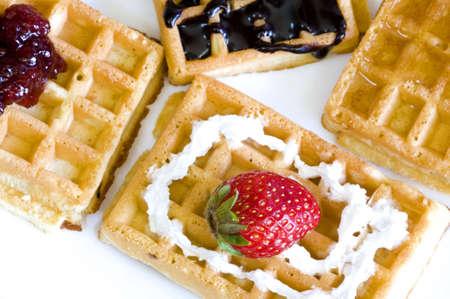 delicious freshly made waffles, whip cream and berry Banco de Imagens