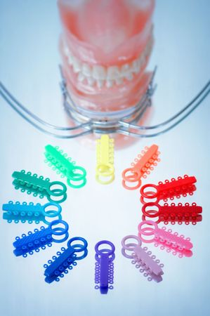 Multicolored ligature ties , facebow and dentures Stock Photo - 7044383
