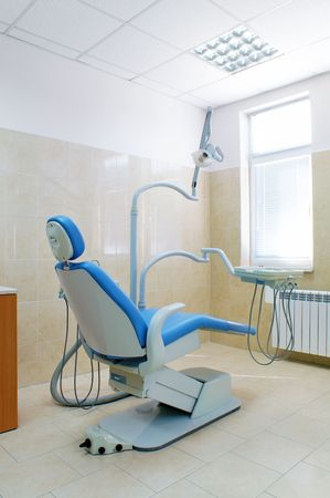 Interior of a dental clinic , dental chair and equipment Stock Photo - 7602554