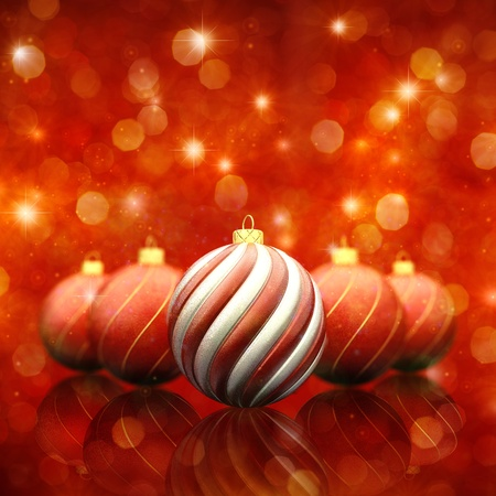 Christmas baubles on red sparkly background photo