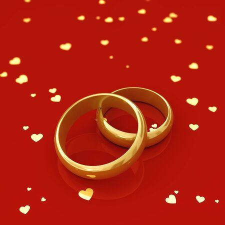 Golden wedding rings and hearts on red background photo