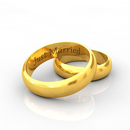 vow: Engraved golden wedding rings on white background with reflection