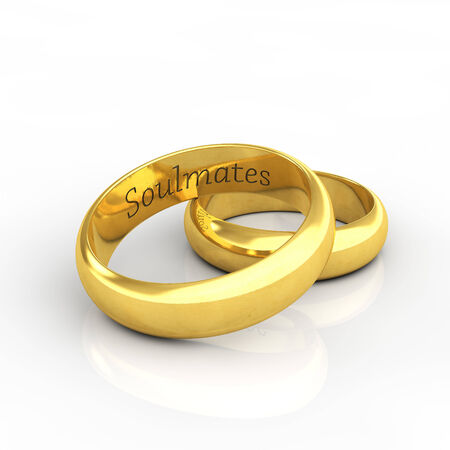 vow: Engraved golden wedding rings on white background with reflection , Soulmates