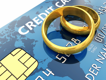 safe money: Golden wedding rings and credit card Stock Photo