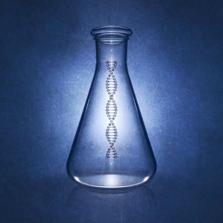 replication: DNA double helix molecule in laboratory flask on blue background