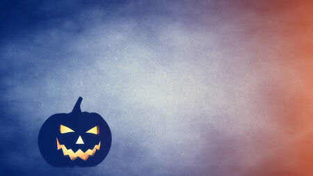 frighten: Halloween carved pumpkin on blue  orange background , jack o lantern