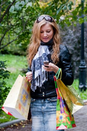beautiful young woman carrying shopping bags photo
