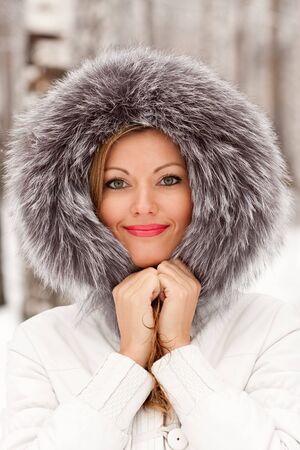 fur hood: Pretty girl in a park Stock Photo