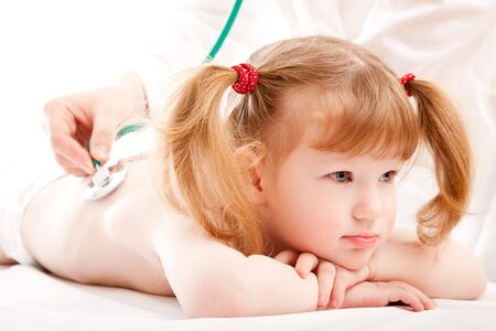 Little caucasian girl in a hospital. photo