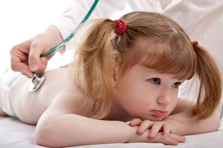 Little caucasian girl in a hospital. photo
