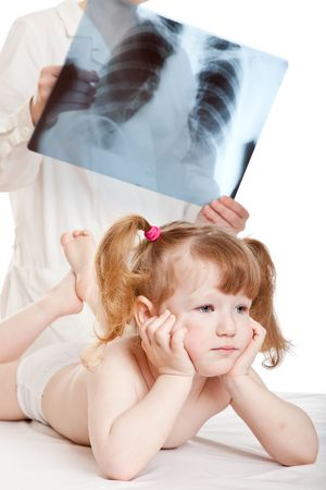 Doctor visits little girl and looking at an x-ray picture photo