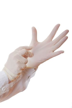 Close-up of hand of surgeon helping to put sterile glove on the other one photo
