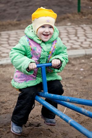 A cute child playing at the playground photo