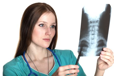 torax: Young female doctor looking at the xray picture Stock Photo