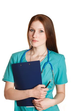 Portrait of serious female doctor in the green uniform photo
