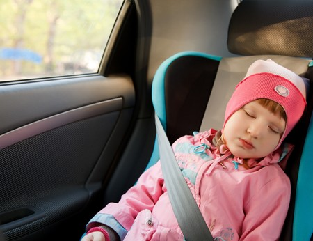 asleep chair: Cute little caucasian girl sleeping in a car.